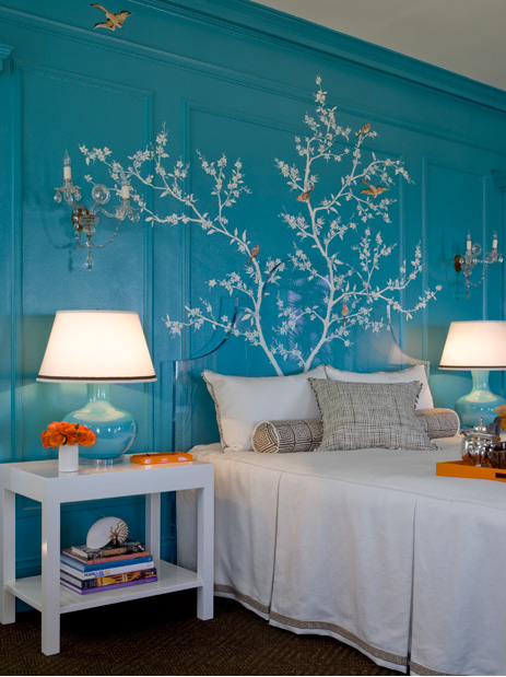 blue and orange bedroom with white tree mural